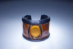 Brown leather bracelet with yellow stone Stock Photography