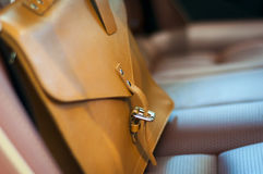 Brown leather briefcase. On the car back seat royalty free stock photos