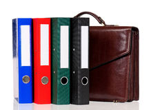 Brown leather briefcase with folders Royalty Free Stock Images
