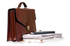 Brown leather briefcase with folders Royalty Free Stock Image