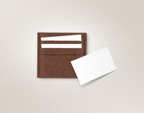 Brown leather cards holder with blank white card mock up Royalty Free Stock Photo