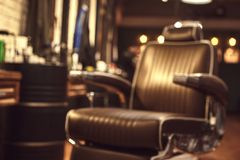 Brown leather chair in barbershop. Loft style stock photo