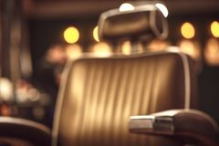 Brown leather chair in barbershop. Loft style royalty free stock images