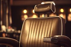 Brown leather chair in barbershop. Loft style royalty free stock photo