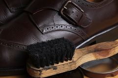 Brown leather classic Brogue shoes with polishing cream and wooden brush Royalty Free Stock Photos
