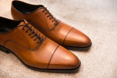 Brown leather classic male shoes on the floor.  Royalty Free Stock Photo