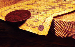 Brown leather coin purse with old and vintage coins. On a wooden table with many antique coins Royalty Free Stock Photography