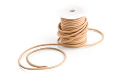 Brown leather cord on plastic spool Royalty Free Stock Photos