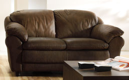 Brown leather couch and table stock photography