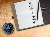 Brown Leather cover note book and Compass Royalty Free Stock Photo