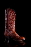 A brown leather cowboy boot Royalty Free Stock Photography