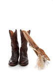 Brown leather cowboy boots on white stock photos