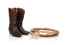 Brown leather cowboy boots on white Royalty Free Stock Images