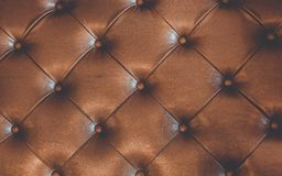 Brown Leather Cushion Texture Background. Decorative Vintage Classic Brown Leather With Buttons Cushion Texture Background stock images