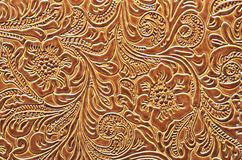 Brown Leather Embossed with a Floral Pattern. A close up photo of a floral pattern embossed on leather Stock Photos