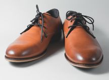 Brown leather executive shoes. Over grey Stock Photos