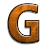 Brown leather G. Individual isolated letter G in brown leather series Stock Photography
