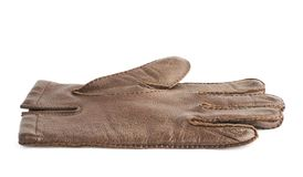 Brown leather glove isolated. Brown leather male glove isolated over the white background Royalty Free Stock Photography
