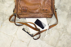 Brown leather handbag, cell phone, diary and glasses Royalty Free Stock Photos