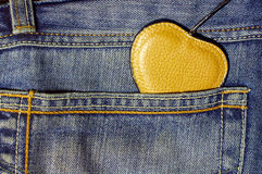 Brown leather heart on jeans pocket background Royalty Free Stock Photo