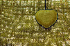 Brown leather heart on old natural material Royalty Free Stock Photos