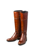 Brown leather high boots Stock Images