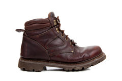 A Brown leather hiking boot on white. A brown leather hiking boot on a white background Stock Photos