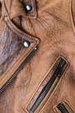 Brown leather jacket. Close-up of a worn brown leather jacket royalty free stock images