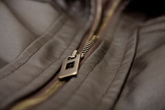 Brown leather jacket. A brown leather jacket close up shot. Focus is on zip Stock Images