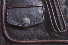Brown leather jacket. Close up. Nice Design Brown leather jacket with Harley Davidson button stock photo