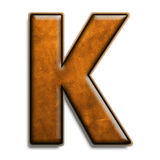 Brown leather K. Individual isolated letter K in brown leather series Royalty Free Stock Images