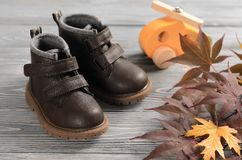 Brown leather kids shoes on wood backdrop. autumn concept Royalty Free Stock Photography