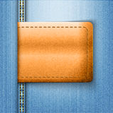 Brown leather label on blue jeans background Royalty Free Stock Photo