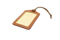 Brown Leather luggage tags label. Brown leather label tag, isolated on the white background Royalty Free Stock Photography