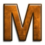 Brown leather M. Individual isolated letter M in brown leather series Royalty Free Stock Photos