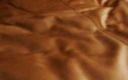 Brown Leather Material. Yards of soft brown leather material are laid across a table Royalty Free Stock Photo