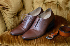Brown leather medallion toe wholecuts shoes. Men accessories, Brown leather medallion toe wholecuts shoes royalty free stock photography