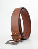 Brown leather men belt on white. Picture of a Brown leather men belt on white Royalty Free Stock Images