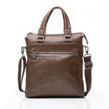Brown leather men casual or business bag. Modern  mustard color leather men casual or business briefcase isolated on white background Stock Images