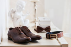 Brown leather men`s shoes with belt, bow-tie. Set groom accessories. Stock Image
