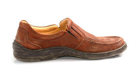 Brown leather men's shoes with wooden shoe stretchers on the sid. Brown leather men's shoes with wooden shoe stretchers on the side Stock Photo