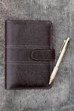 Brown leather notebook and ballpoint Royalty Free Stock Photos