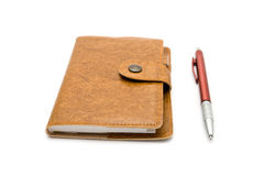 Brown leather notebook with a pen Stock Images