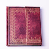 Brown leather old note book with gold ornament Royalty Free Stock Photo