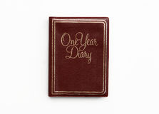 Brown Leather One Year Diary Note Book. Textured Brown Leather One Year Diary Note Book with Gold Trim isolated on a white background Royalty Free Stock Photo