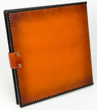 Brown leather photo album cover with decorative frame Stock Photos
