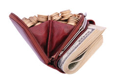 Brown leather purse full of coins and bank-paper. Royalty Free Stock Images