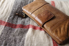 Brown leather purse on a hessian fabric Stock Photos