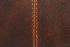 Brown leather with seam. Closeup of brown leather with seam stock image