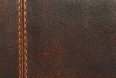 Brown leather with seam. Closeup of brown leather with seam stock photo